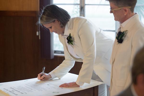 Leah Langley Photography - orlando wedding photographer - quaker wedding - LGBTQ wedding - Orlando LGBTQ wedding photography - Orlando Quaker Meeting - signing marriage document
